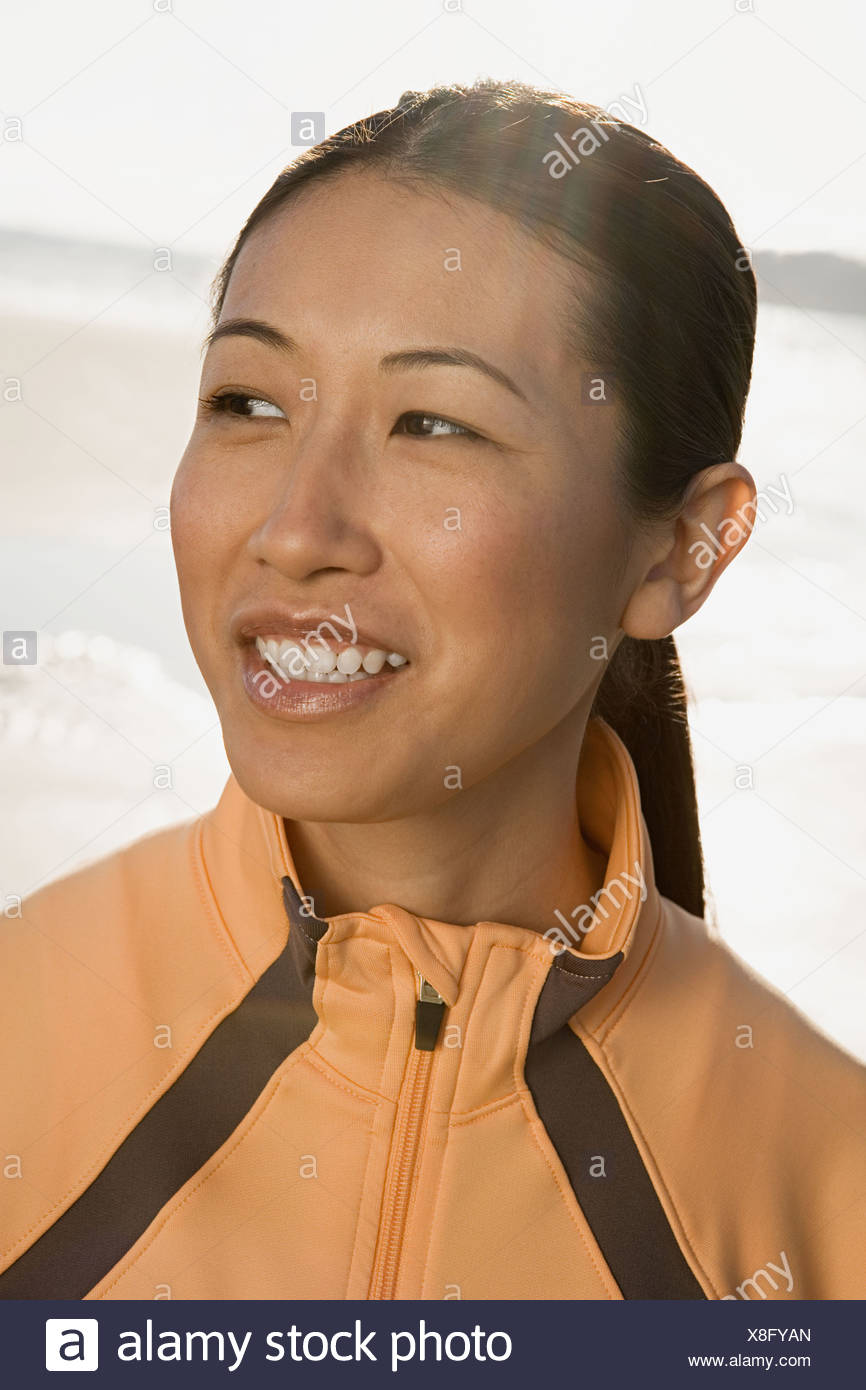 Woman wearing a tracksuit top - Stock Image