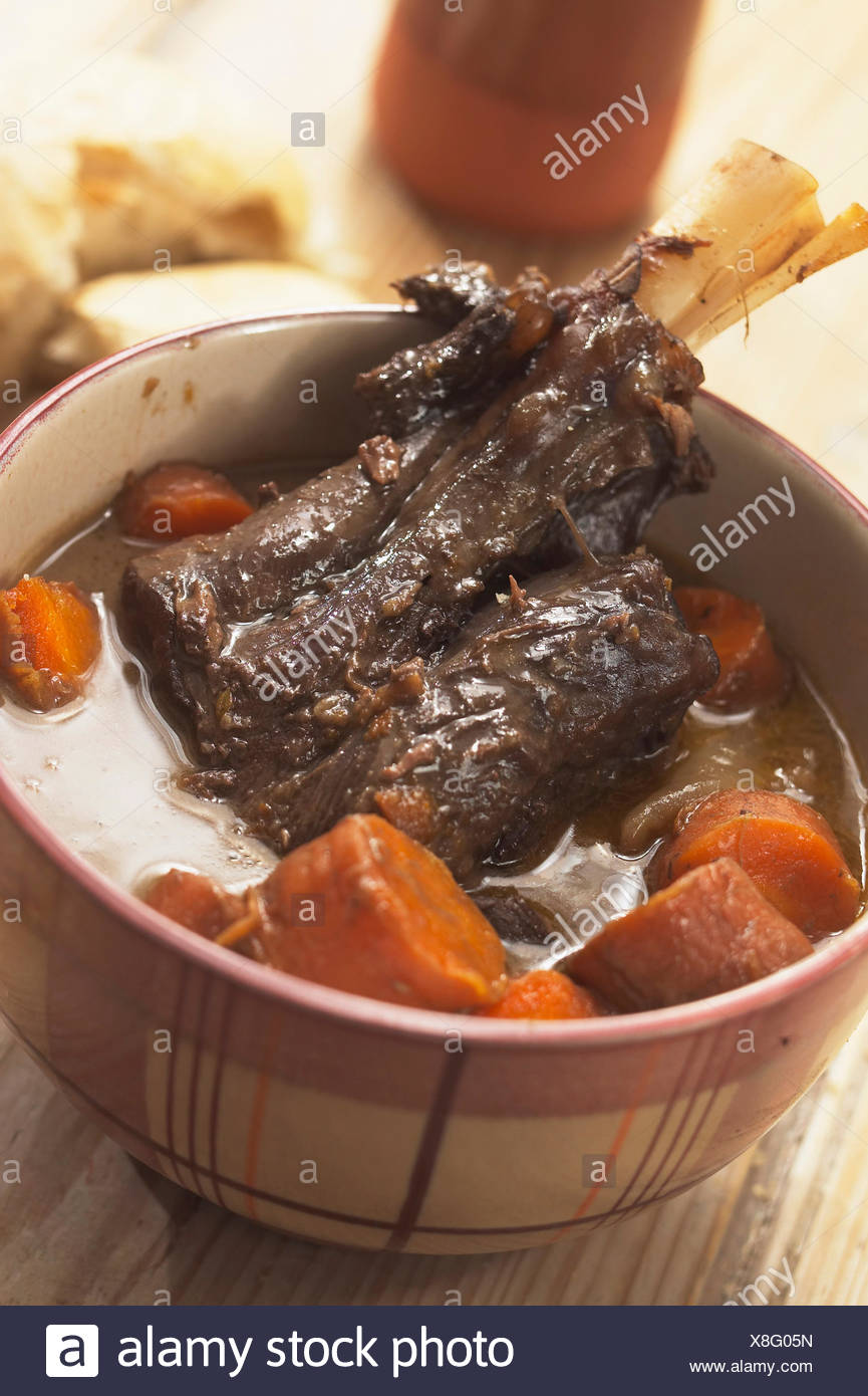Lamb Shank Served With Winter Vegetables - Stock Image