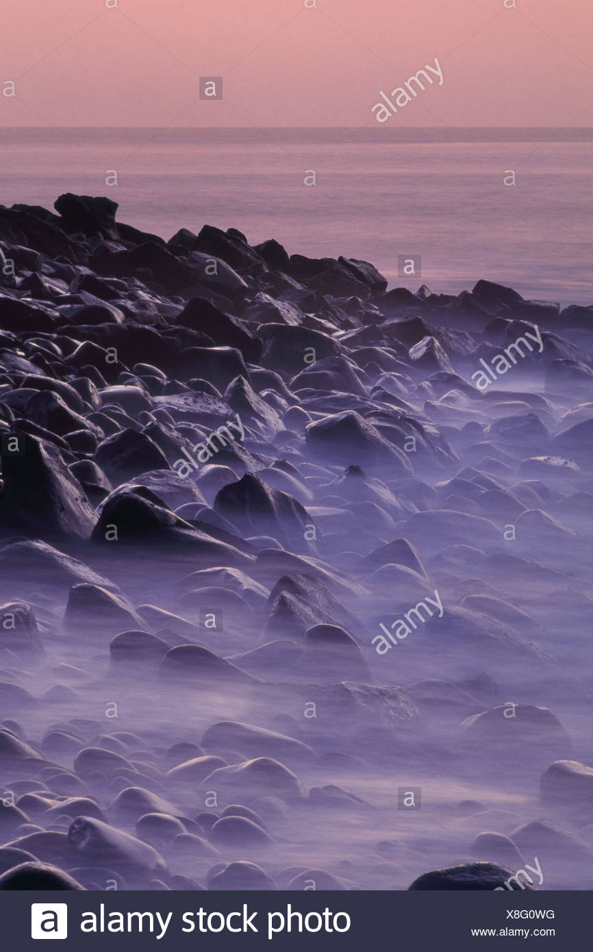 Galapagos Islands Rocky beach at twilight Galapagos Islands - Stock Image