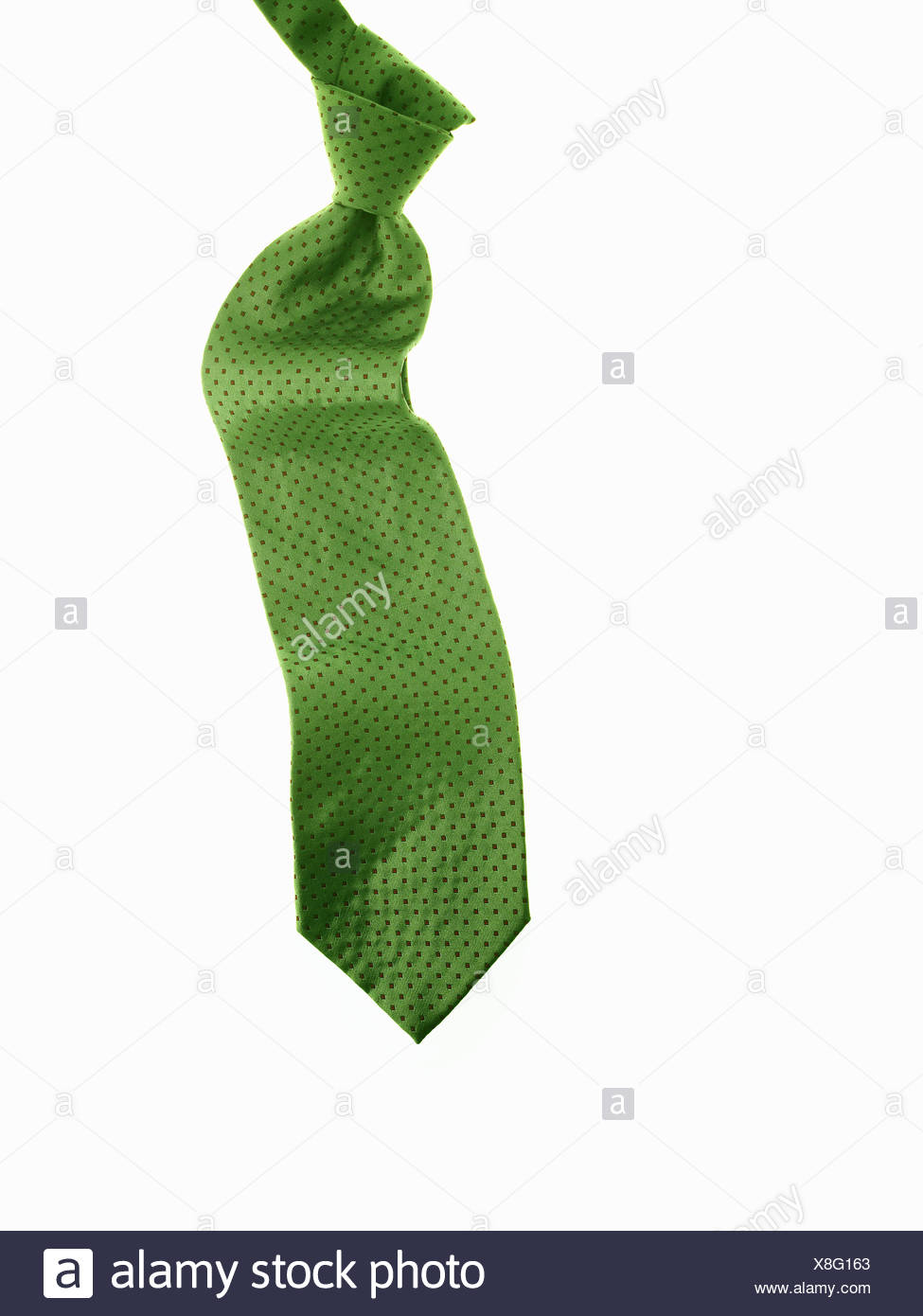 knotted green fabric tie or necktie - Stock Image