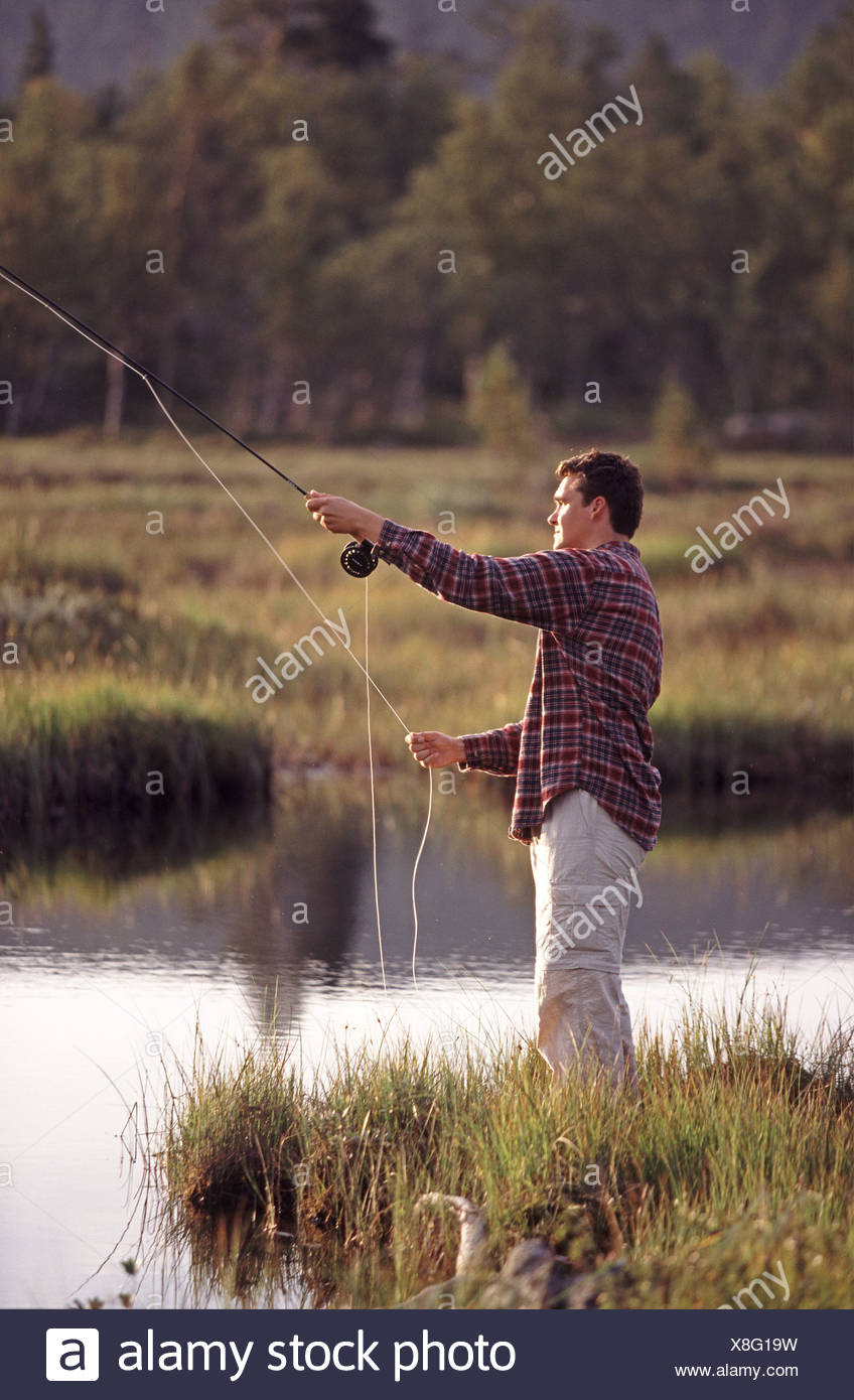 Man flyfishing - Stock Image