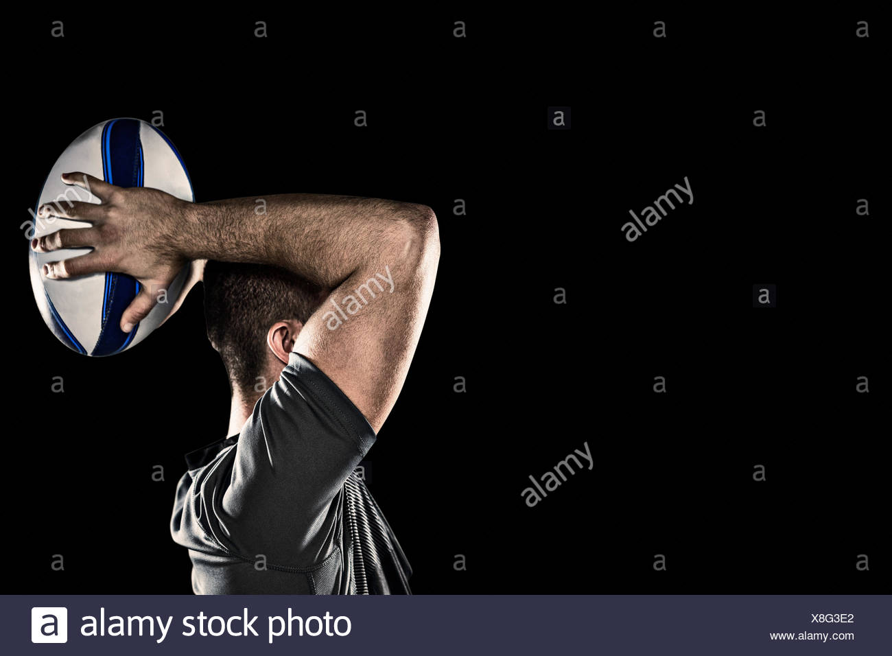 Composite image of rugby player throwing ball - Stock Image