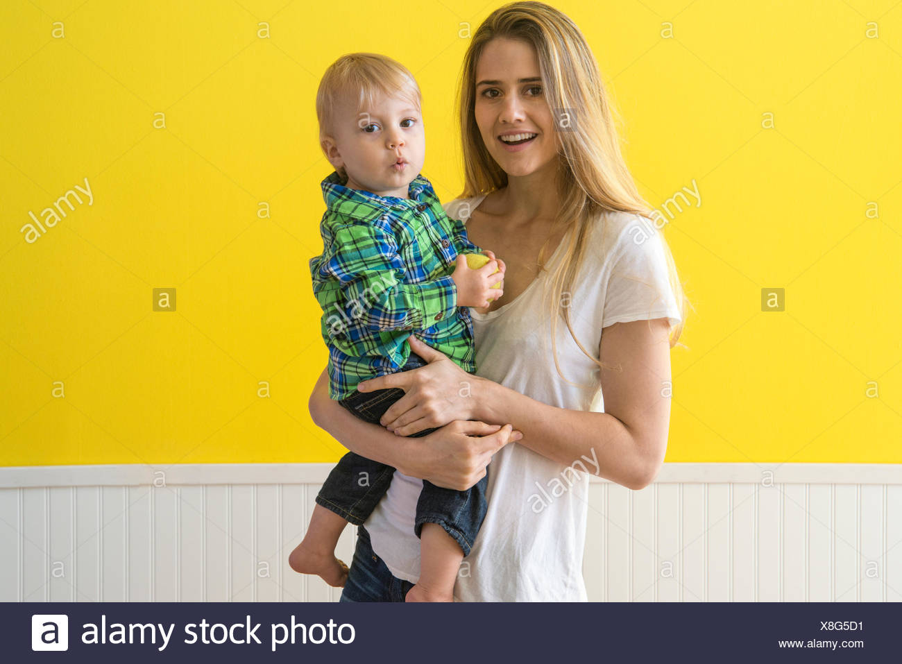 Mother holding her son (12-17 months) - Stock Image