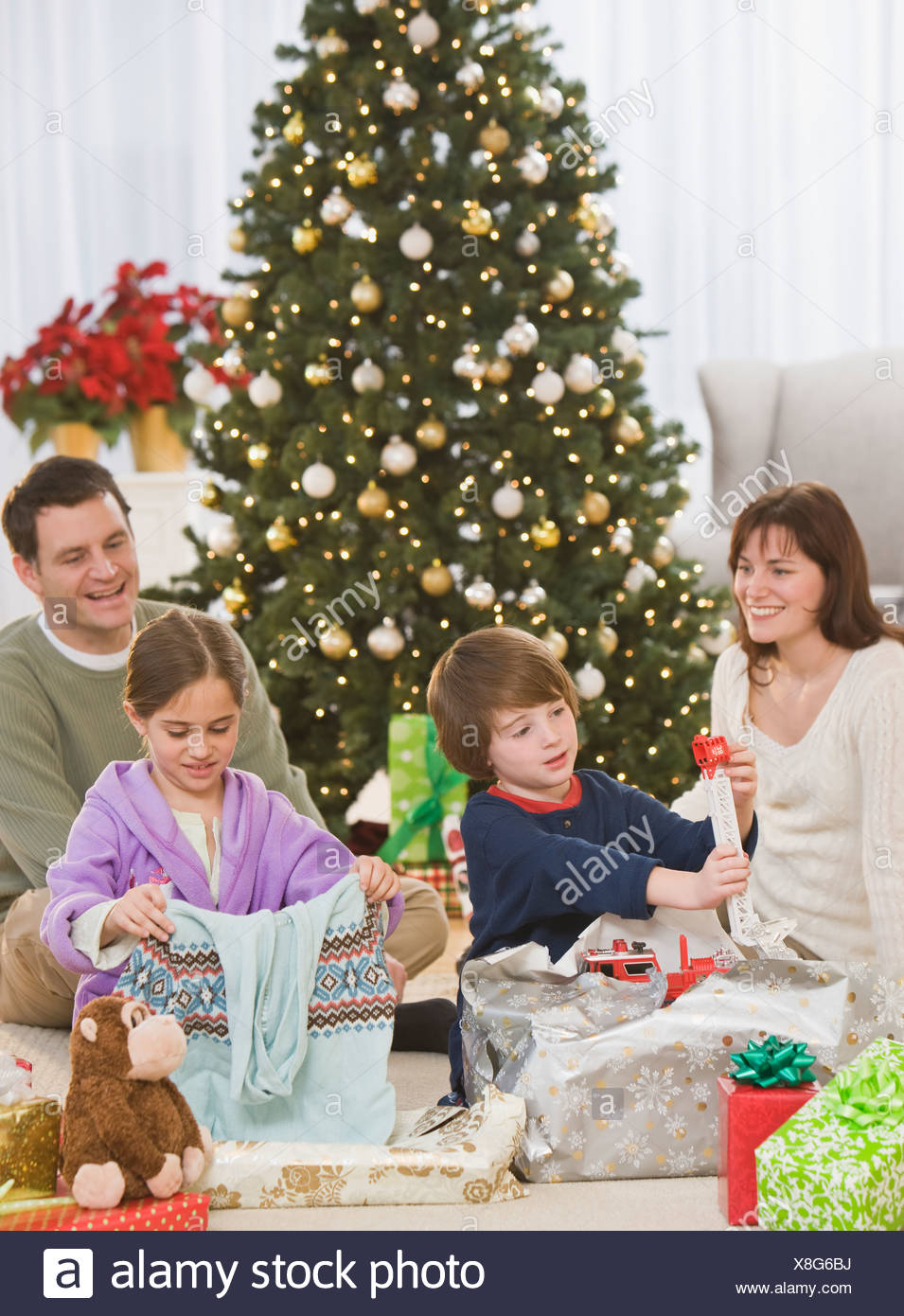 Siblings opening Christmas gifts  sc 1 st  Alamy & Siblings opening Christmas gifts Stock Photo: 280639398 - Alamy