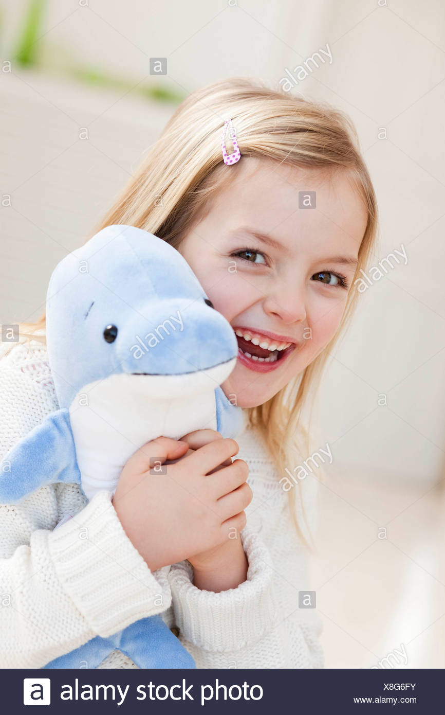 young girl with dolphin - Stock Image