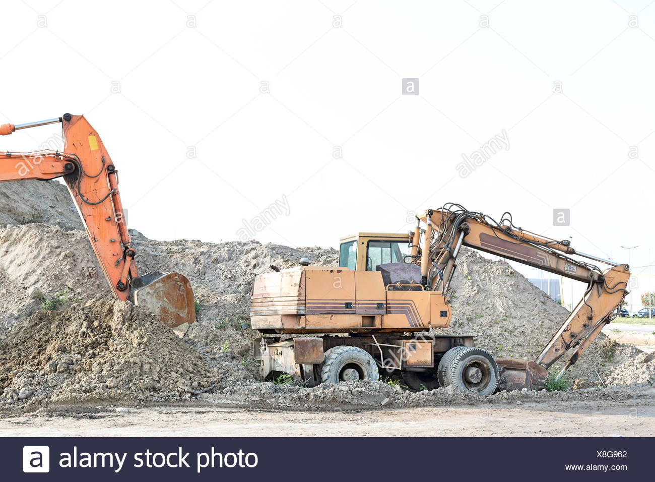 Bulldozers on construction site against clear sky Stock Photo