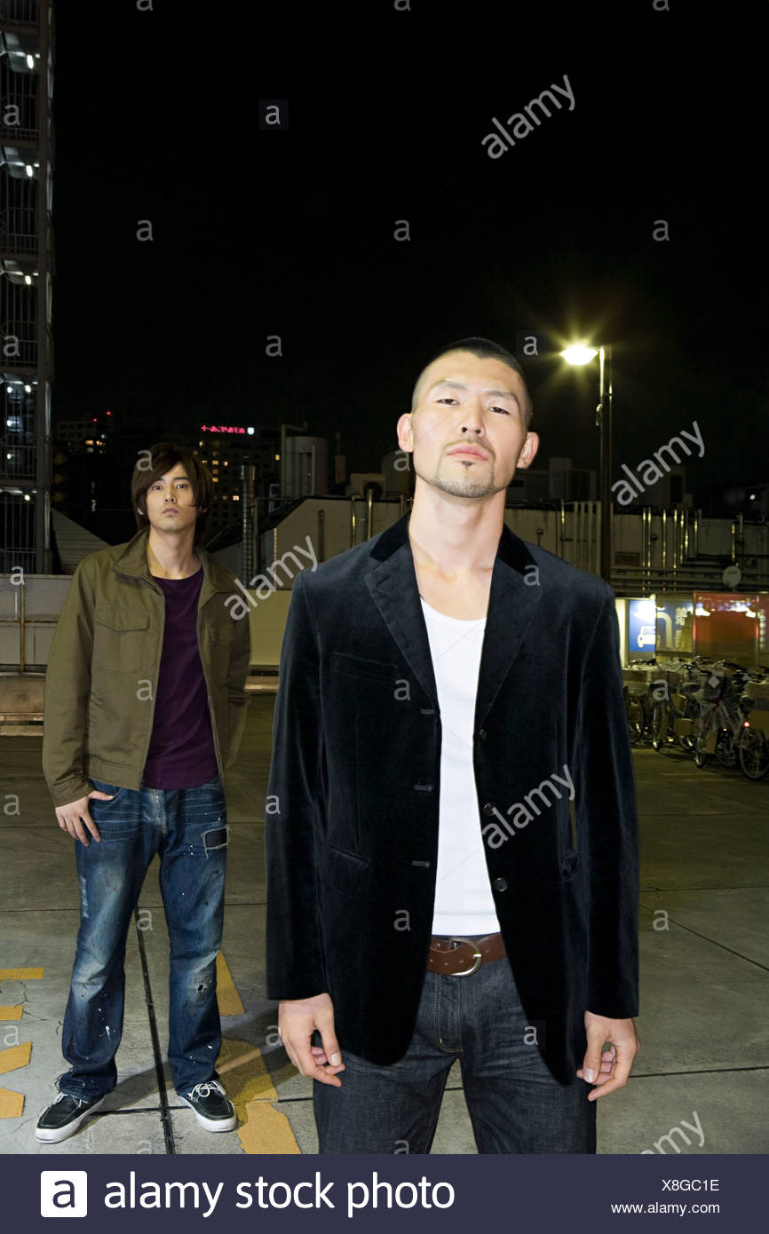 Two young japanese men at night - Stock Image