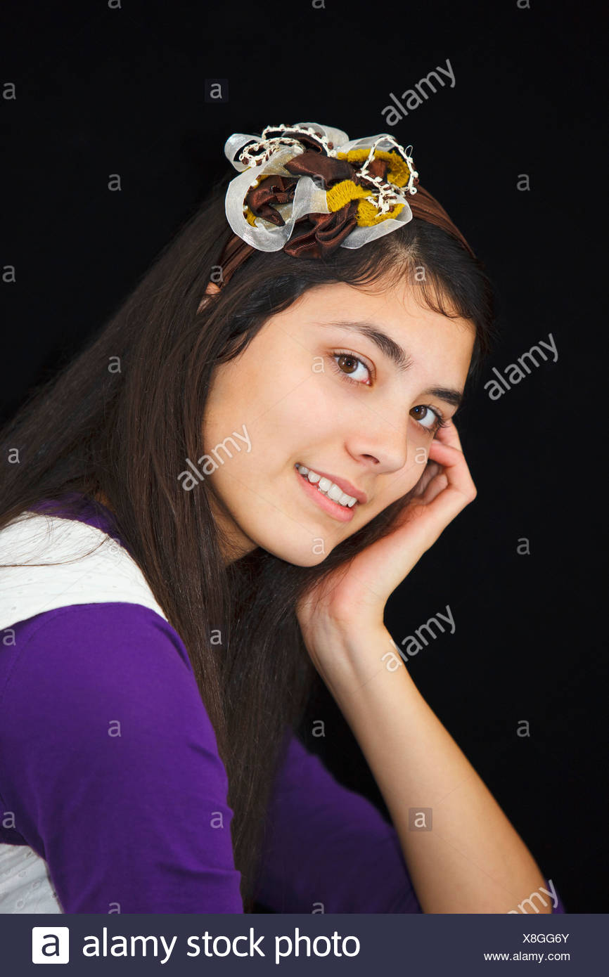 Teenage Girl With A Headband And Flower In Her Long Hair - Stock Image