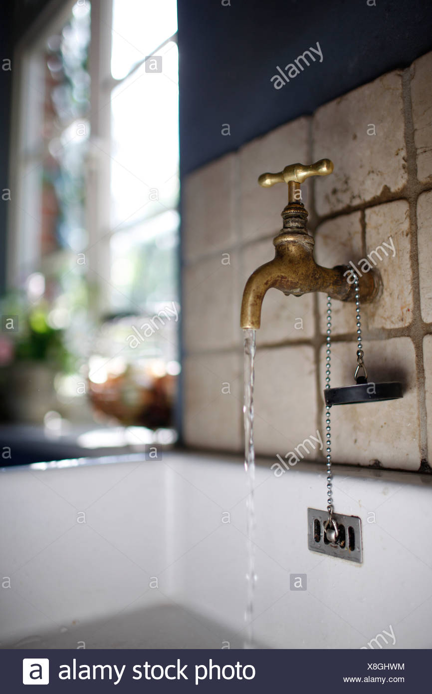 Water tap over a sink, Klein Thurow, Roggendorf, Mecklenburg-Western Pomerania, Germany - Stock Image