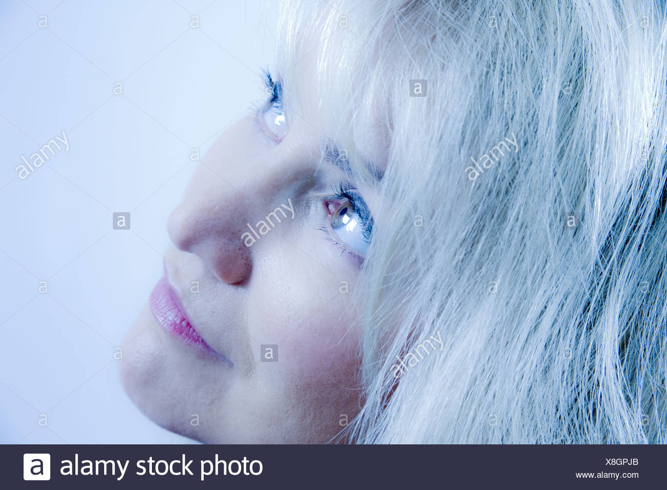 Portrait of middle-aged blonde woman - Stock Image