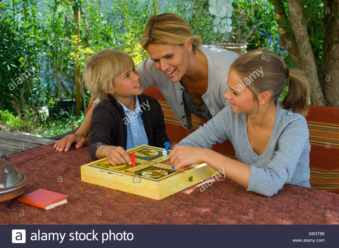 Family playing ludo Stock Photo