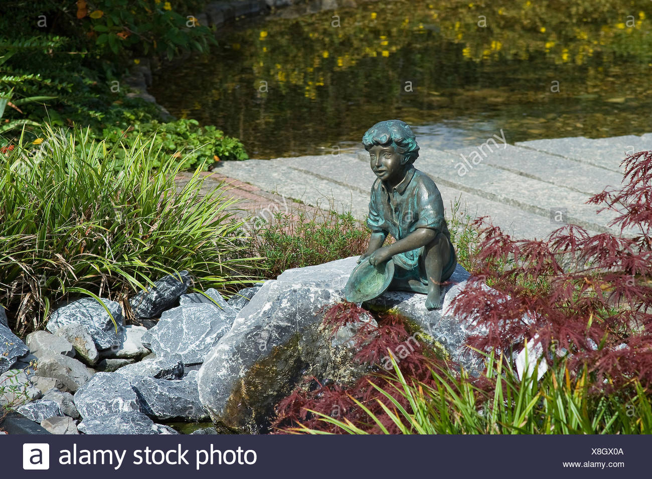 garden beds flower flowers plant youth fresh water pond water gardens flower - Stock Image