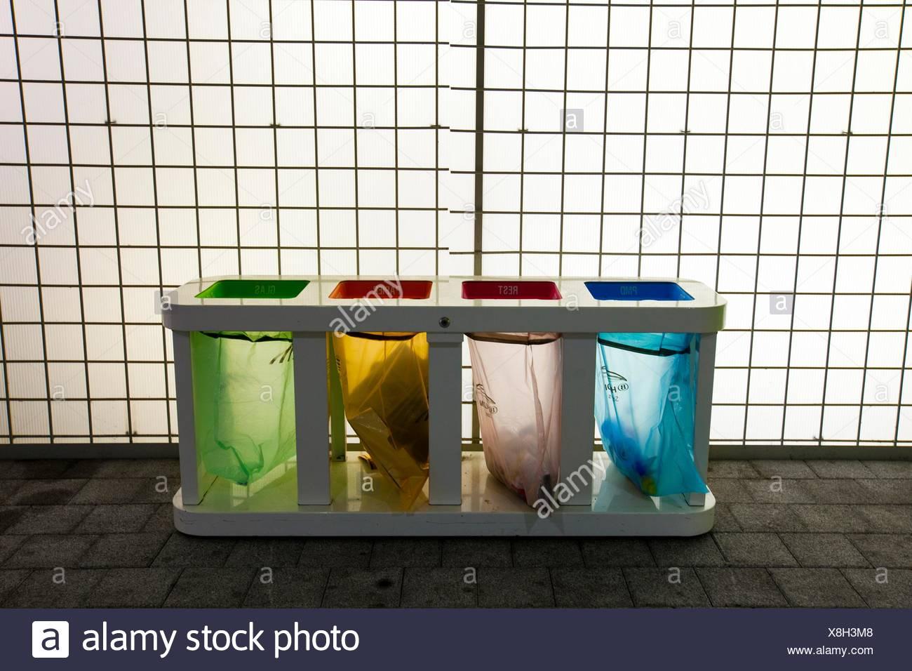 Color transparent recycle bins, Ghent, Belgium - Stock Image