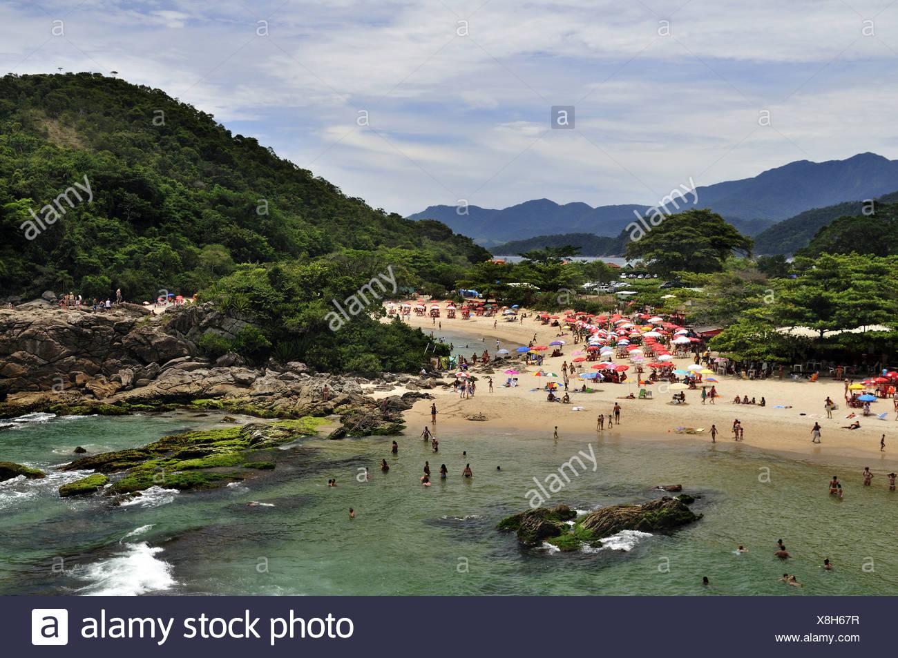 Busy beach in Trinidade, Paraty, Parati, Rio de Janeiro, Brazil, South America - Stock Image
