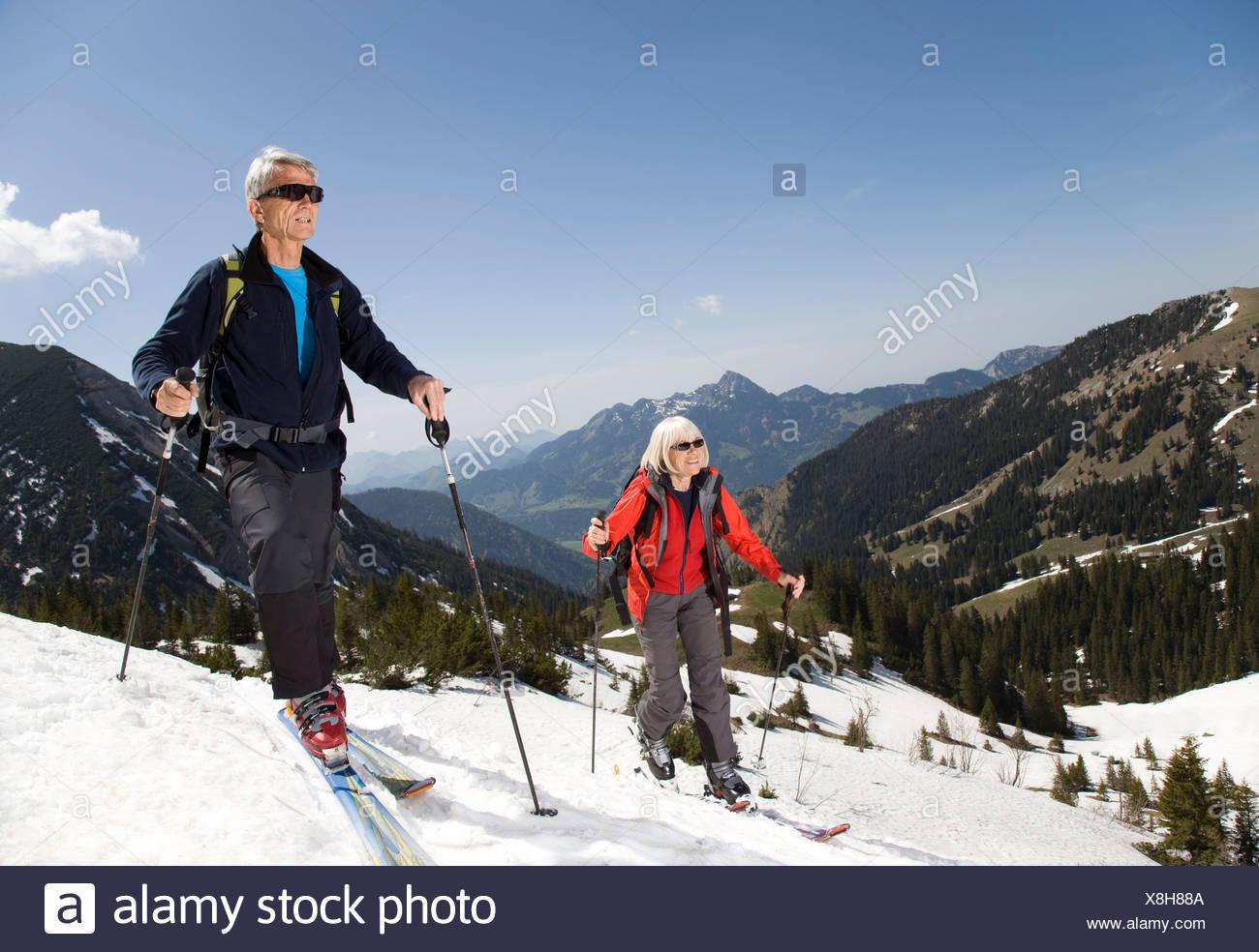 senior couple on ski tour in mountains Stock Photo