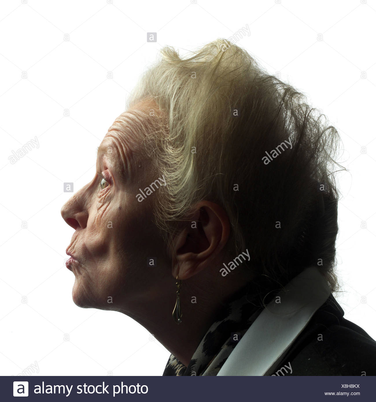 Senior, annoys, tread, model released, studio, cut out, pensioner, woman, old, old age, look, shell, creased, folds, strictly, outrages, outrages, annoys nastily, furiously, get angry, expression, facial play Stock Photo