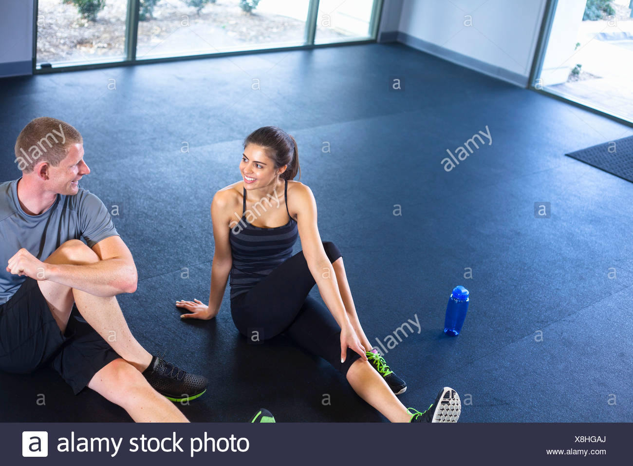 Couple stretching - Stock Image