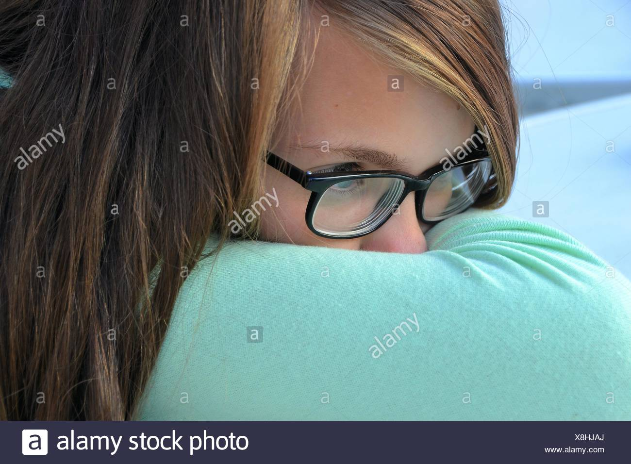 Young pensive girl with glasses Stock Photo