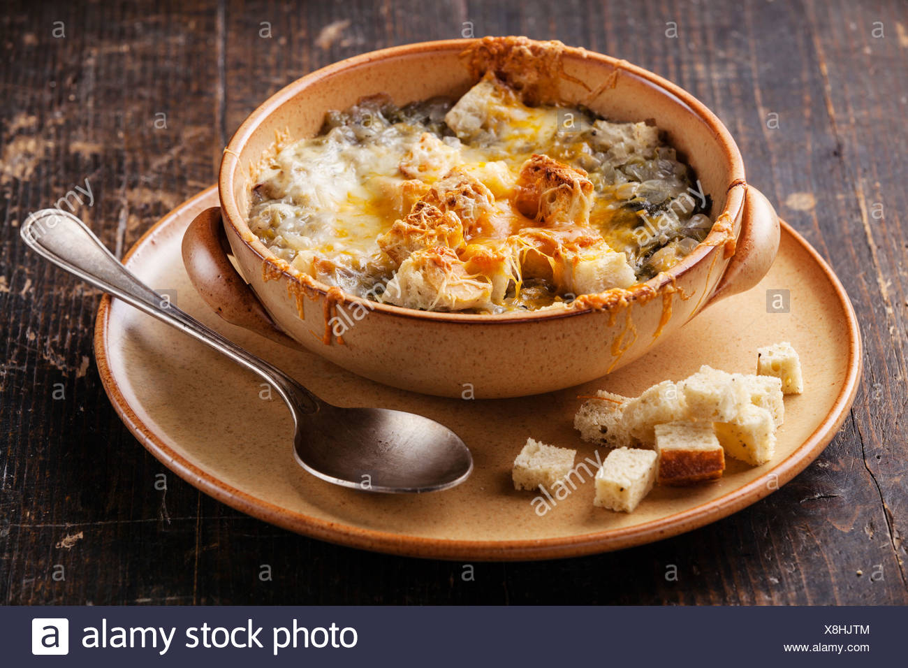 Onion soup with croutons and cheddar cheese - Stock Image