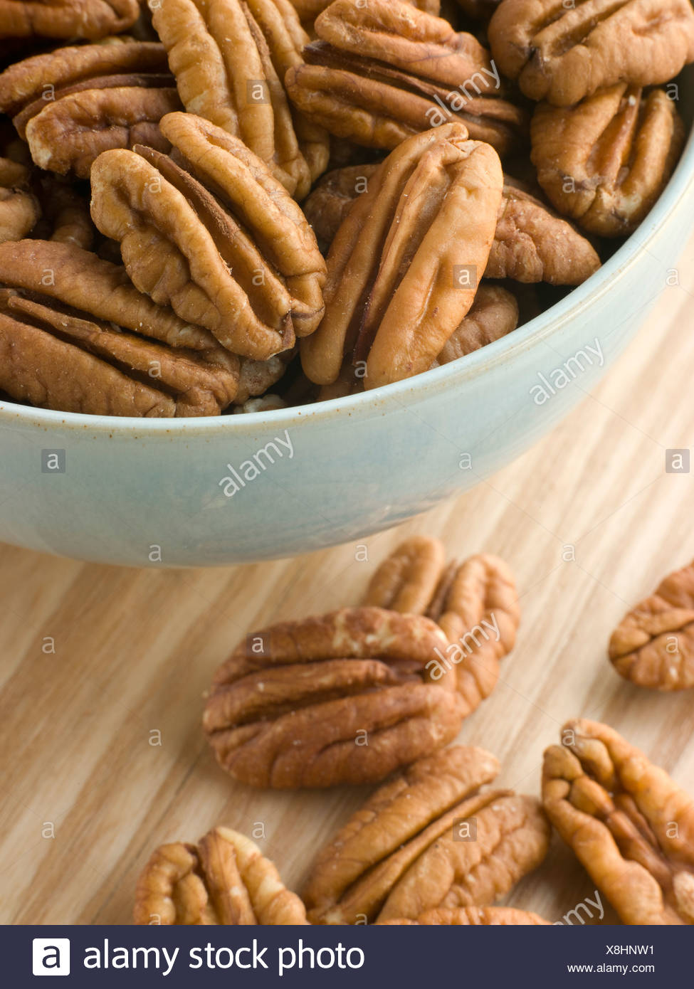 Bowl of Pecan Nuts - Stock Image