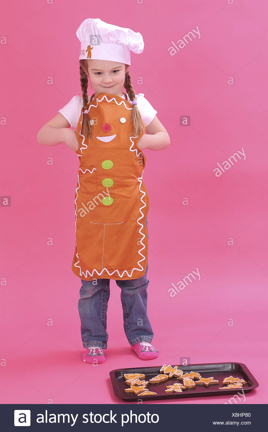 Girls, baking sheet, biscuit, studio, stand, - Stock Image