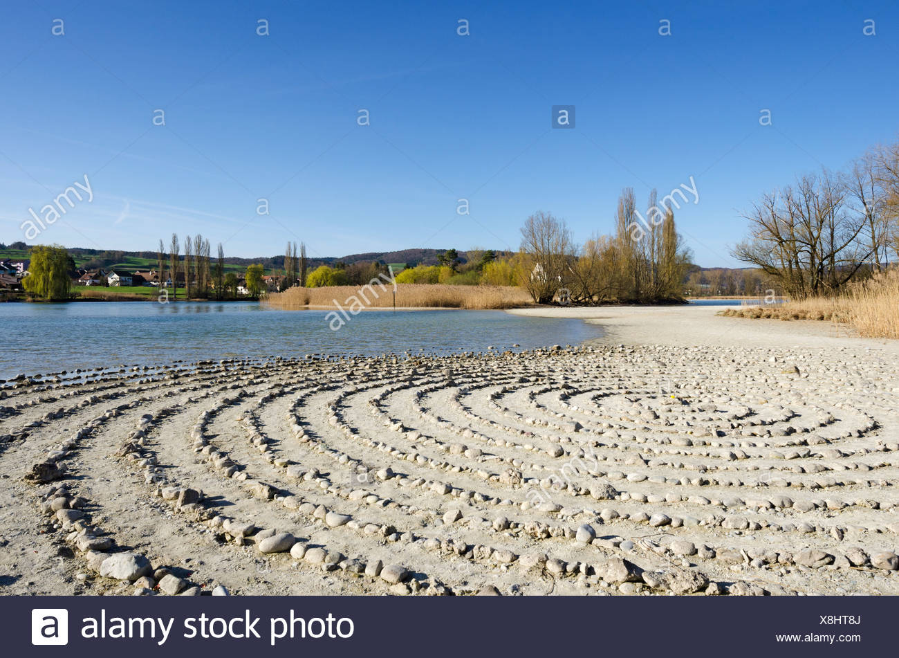 Stone labyrinth on Werd island, can be used for meditation, Werd island at the back, Canton of Schaffhausen, Switzerland, Europe - Stock Image