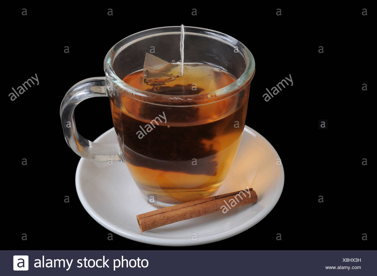 A cup of hot black tea with cinnamon On black Background Stock Photo