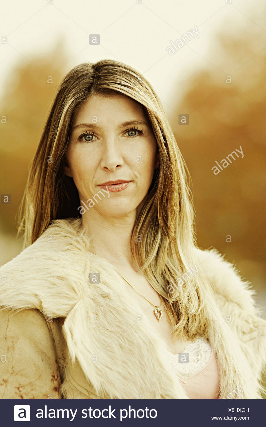 Portrait of a mature woman wearing fur coat - Stock Image