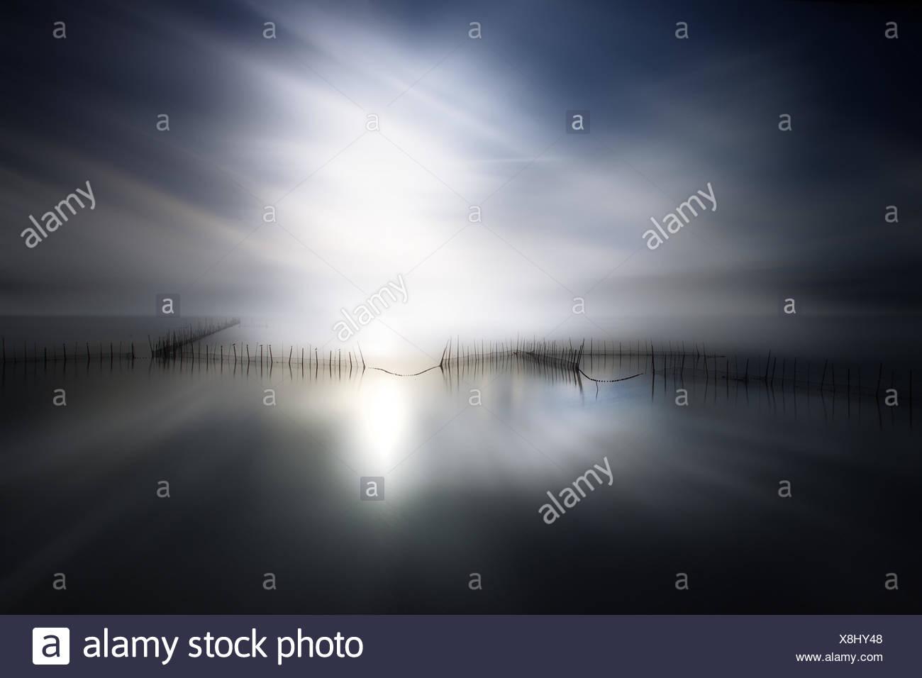 Sunlight over lake - Stock Image