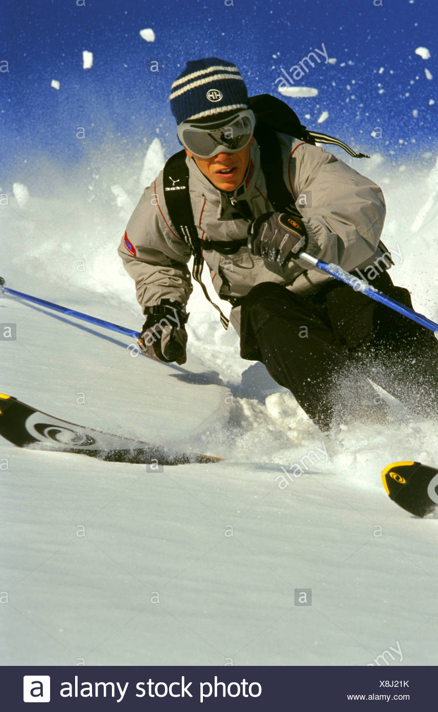 male skier, downhill skiing, off-piste - Stock Image