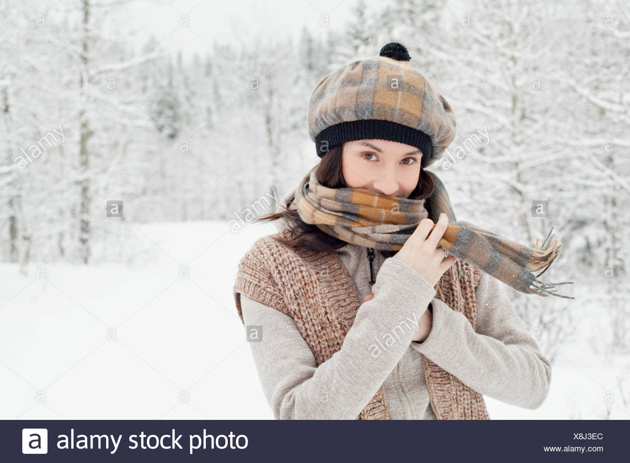 stylish young woman enjoying the outdoors - Stock Image