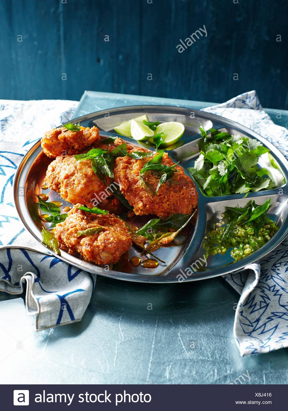 Chicken 65, a spicy deep fried chicken dish - Stock Image