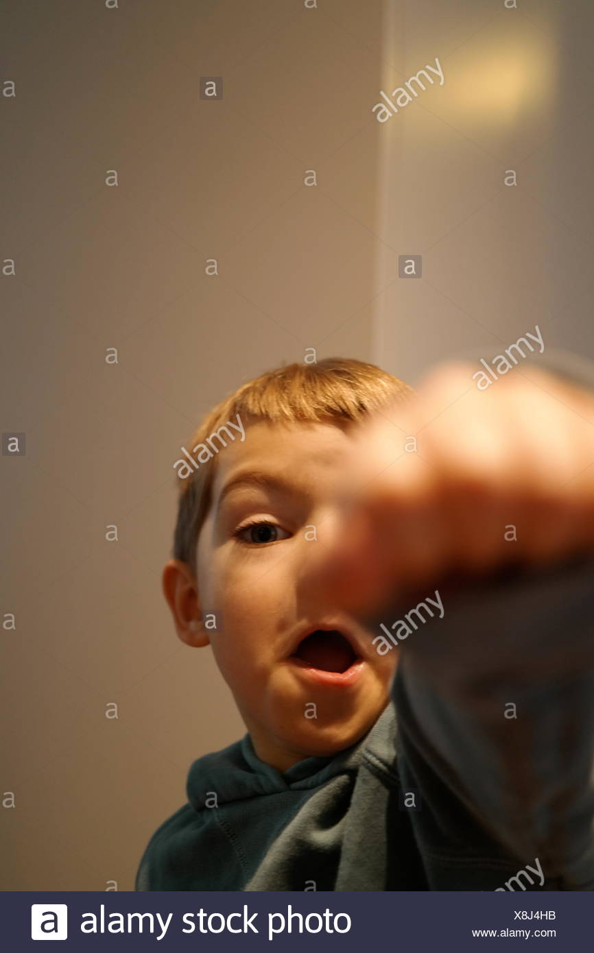 Portrait Of Boy Punching In Air - Stock Image