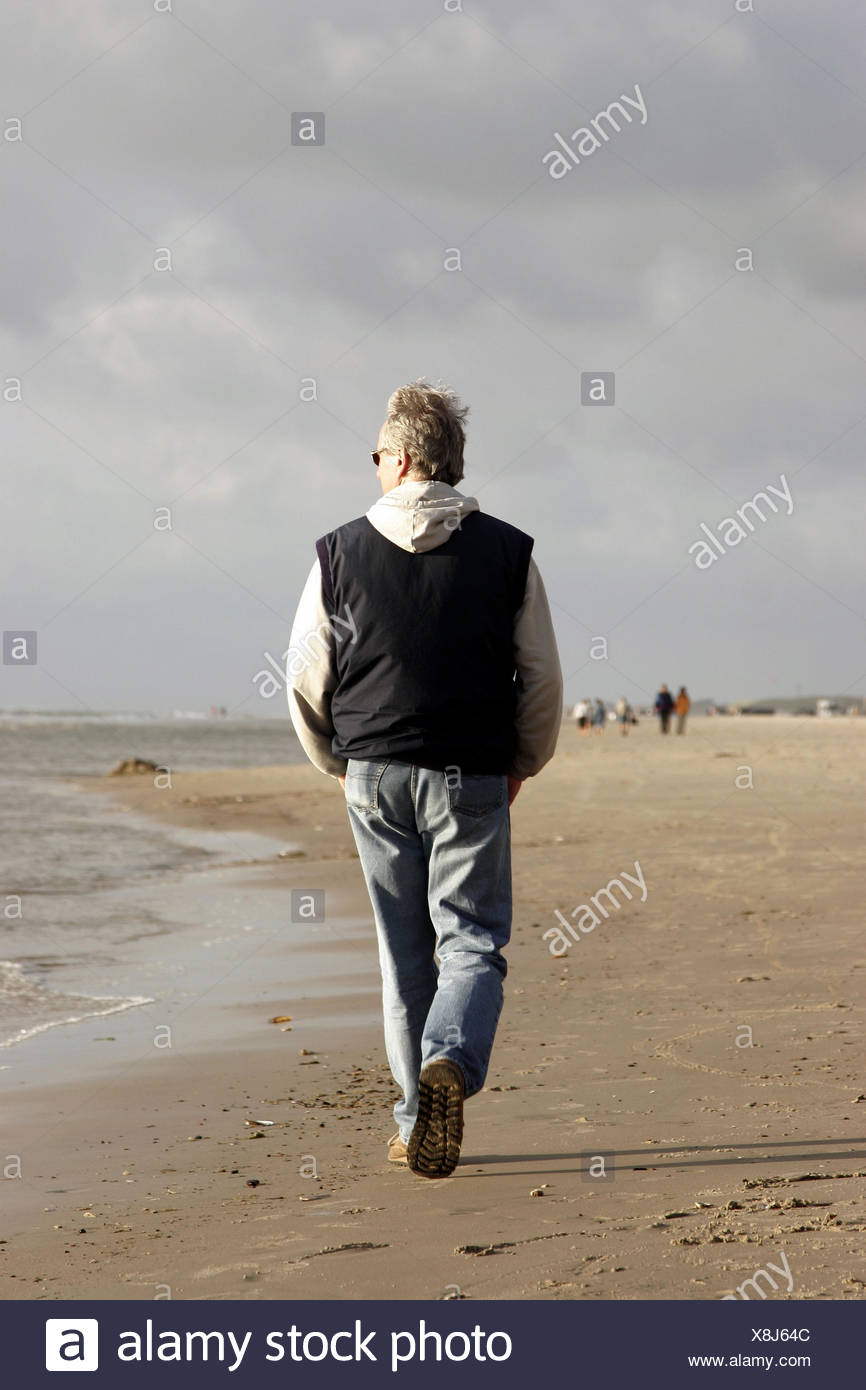 Man, beach-walk, back-opinion, breezy, North sea, North Sea*-beach, sea, summers, beach, sandy beach, man, vacation, beach-vacation, runs, goes, strolls, walks, relaxation, recuperation, landscape, dusk, sunny, clouds, clouds, however, quite-bodies, - Stock Image