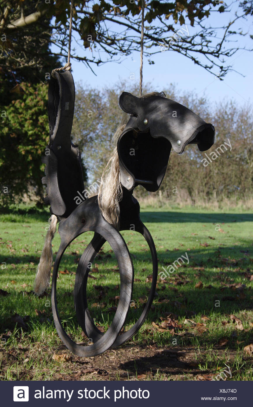 rocking horse swing made from recycled tyres - Stock Image