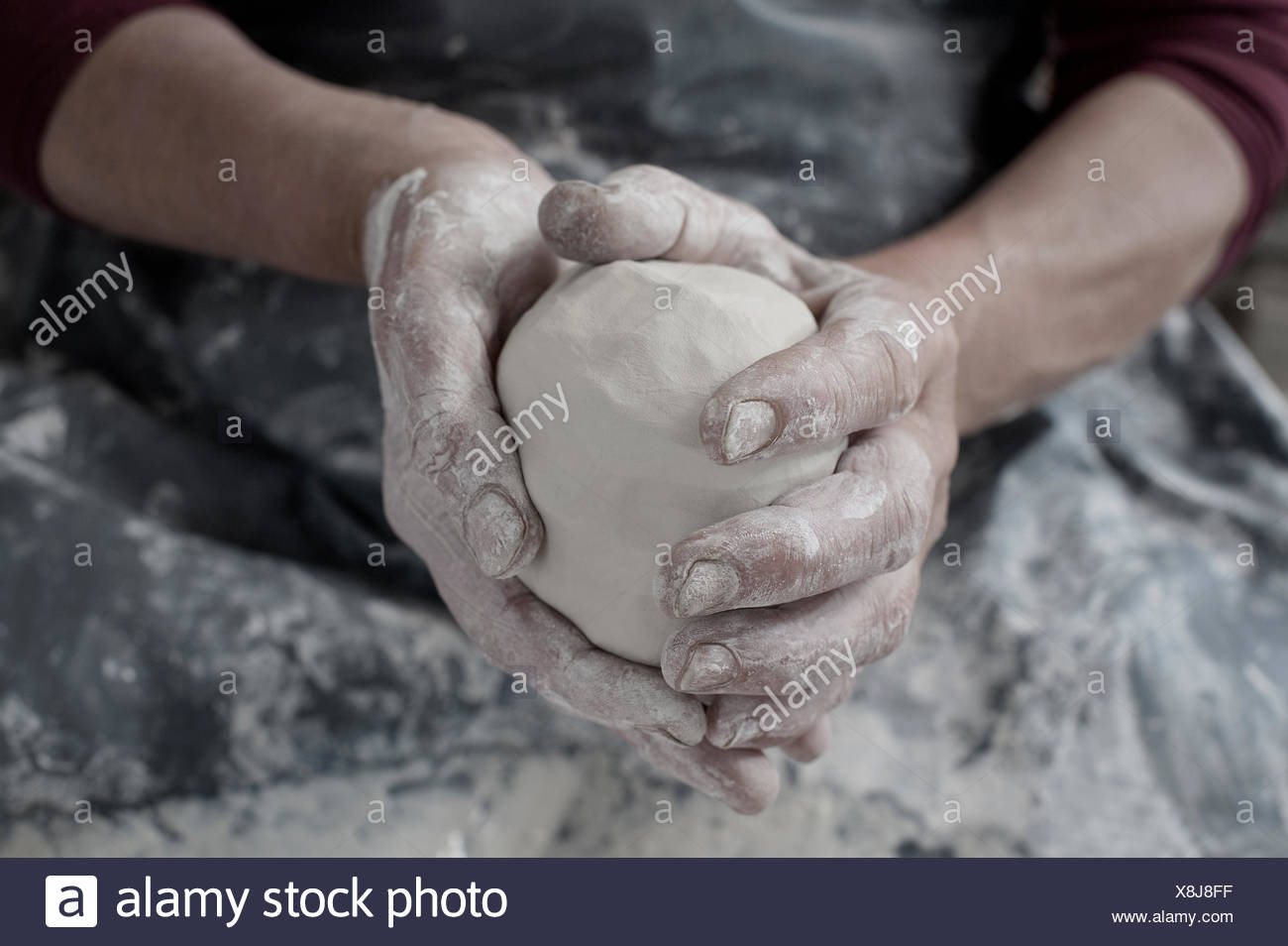 Close-up of female potter's hand holding clay, Bavaria, Germany Stock Photo