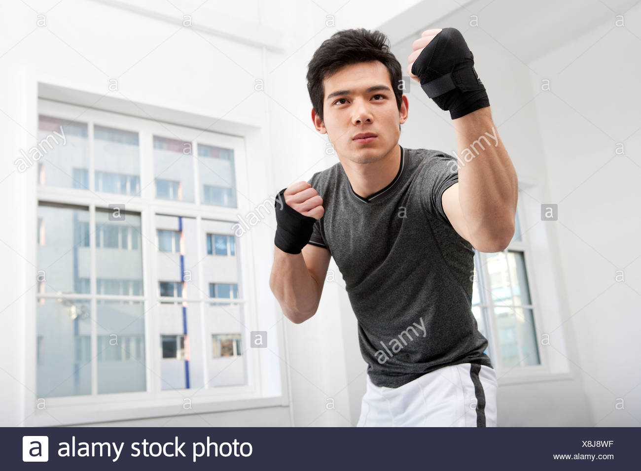 Serious Man in Fighting Stance - Stock Image