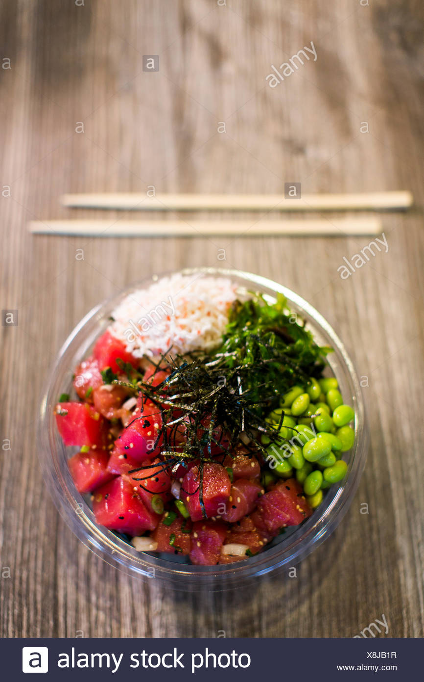 Poke, traditional Hawaiian dish with raw fish and beans, Seattle, Washington State, USA - Stock Image