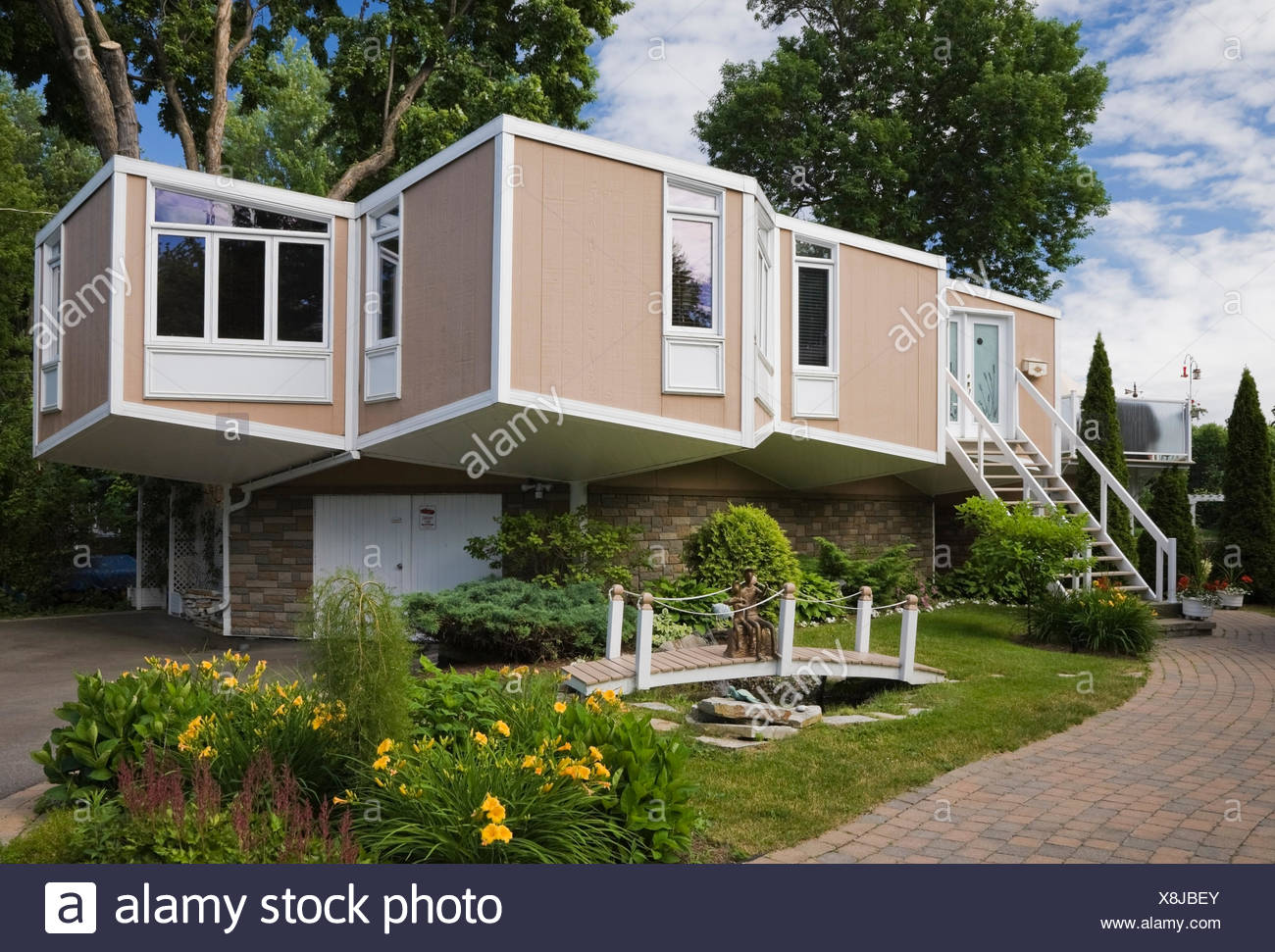 Beige And White Modern Cube Style Residential Home With Landscaped Front  Yard In Summer, Quebec