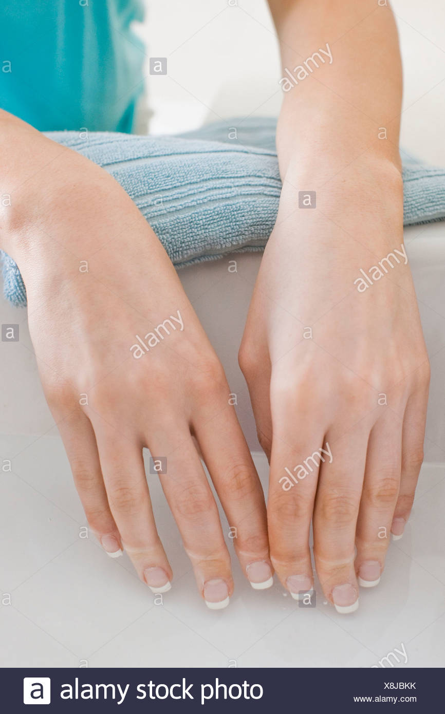Woman soaking hands - Stock Image