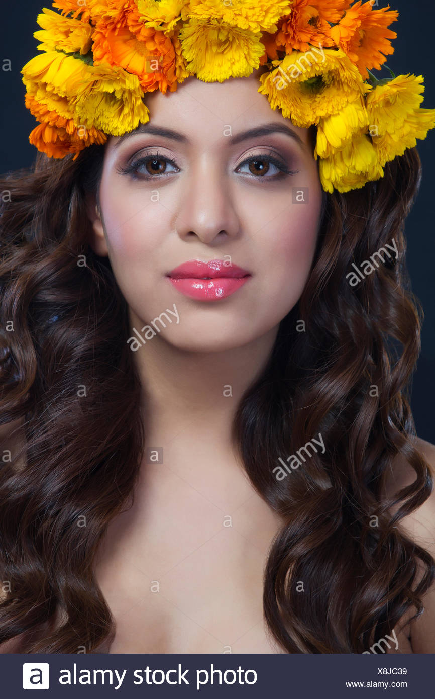 Portrait of a beautiful woman with flowers in her hair stock photo portrait of a beautiful woman with flowers in her hair izmirmasajfo
