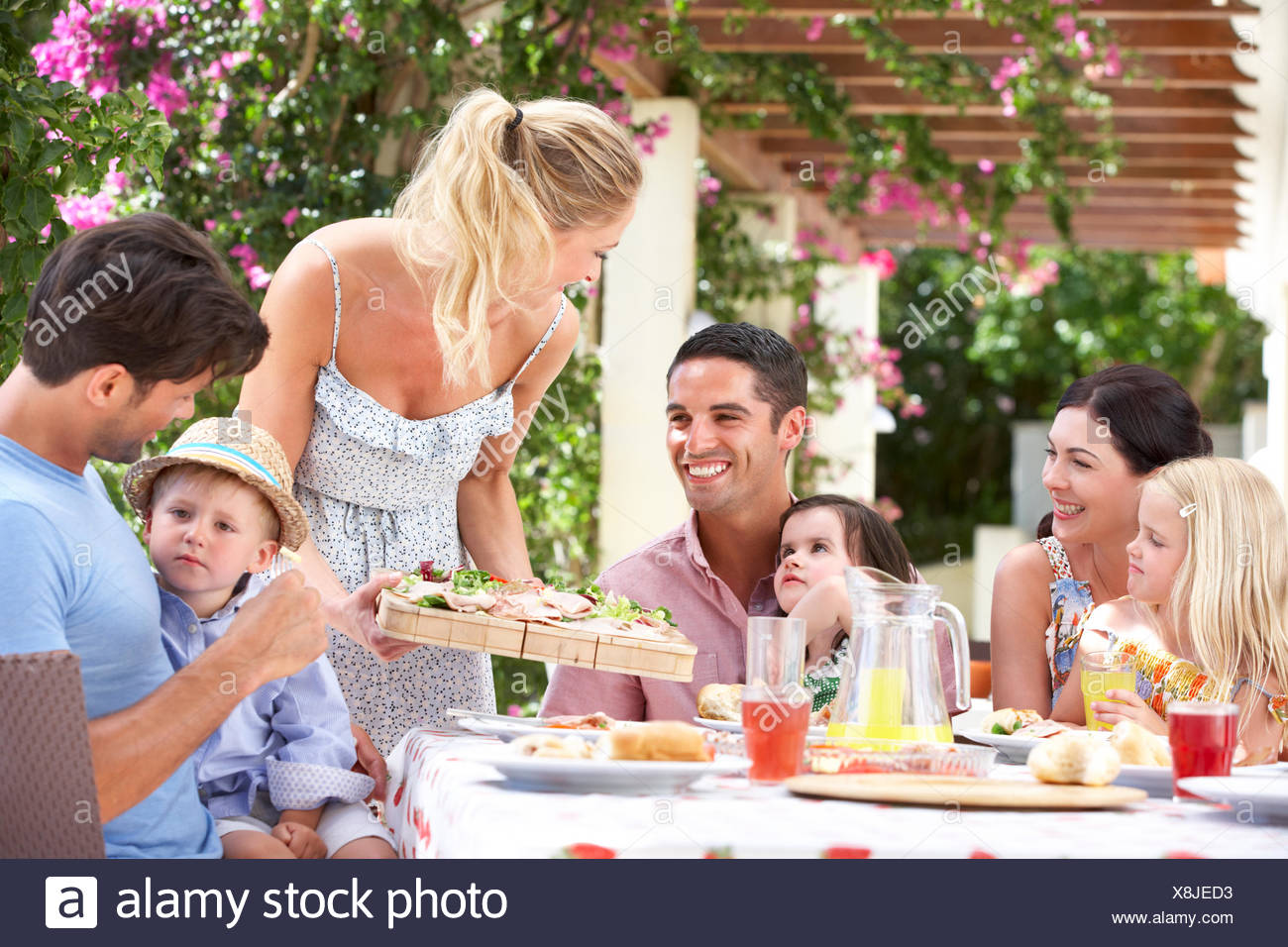 eating,drinking,family,friends,extended family - Stock Image