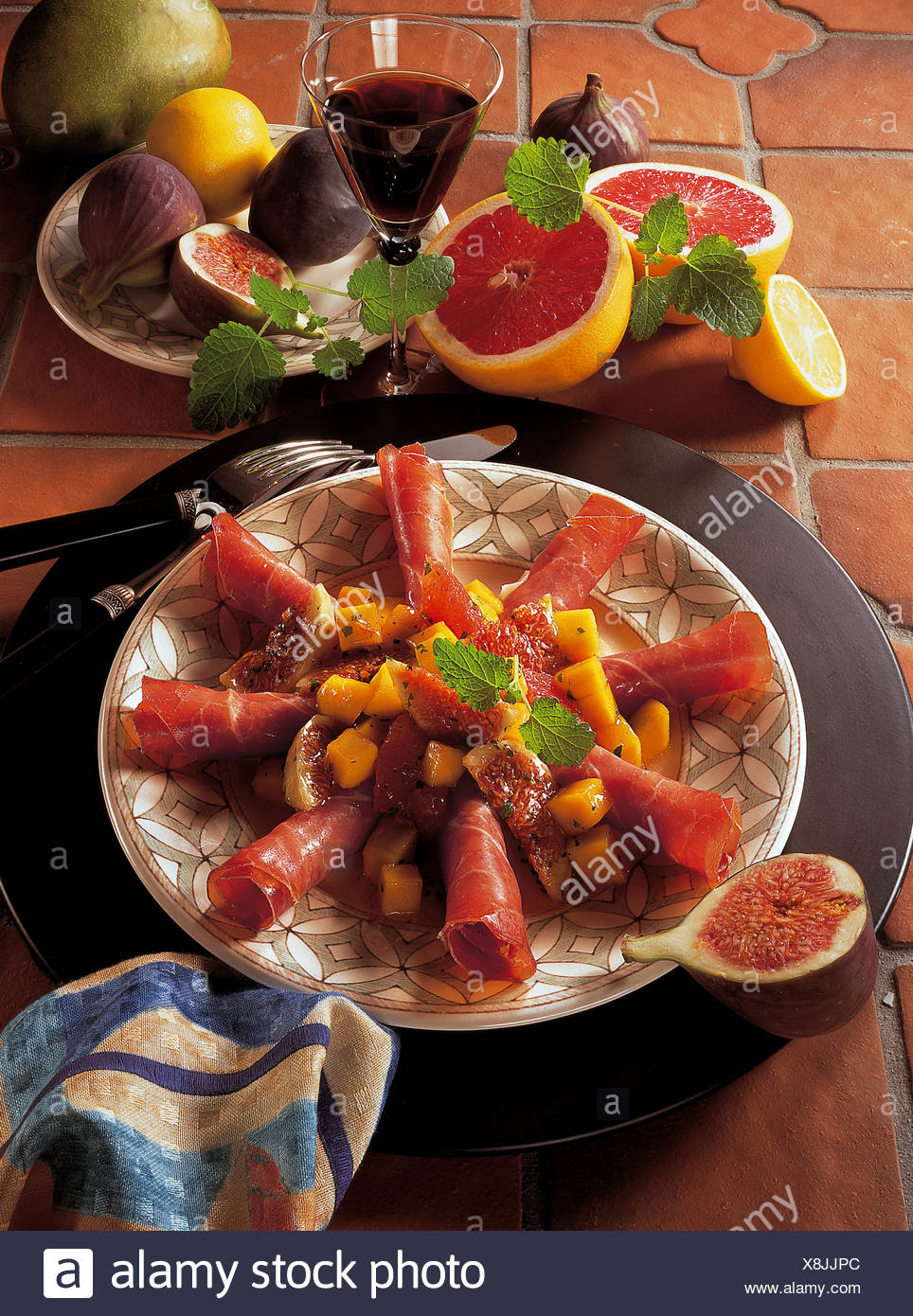Ham with fruit, Portugal, recipe available for a fee - Stock Image