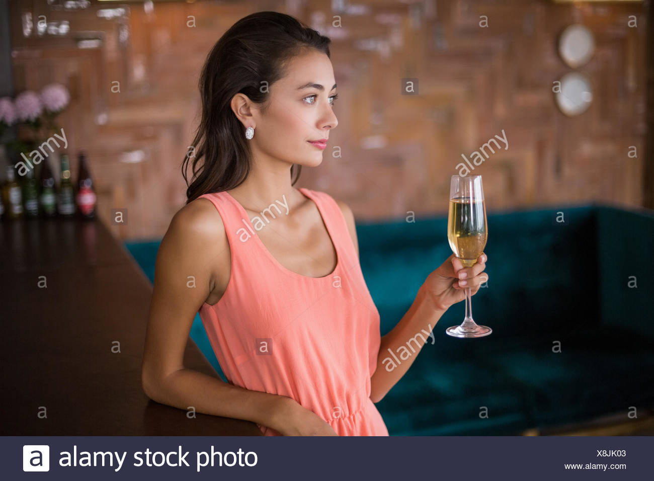 Beautiful woman holding a champagne flute - Stock Image