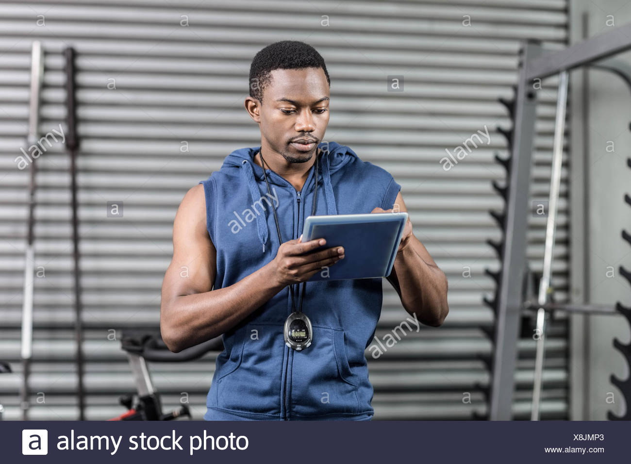 Athletic trainer using digital tablet - Stock Image