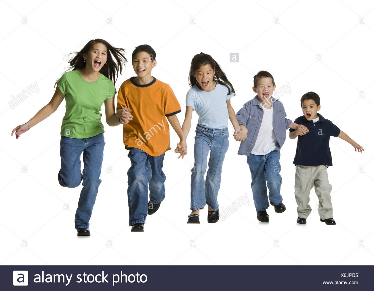 Group of children holding hands and running Stock Photo