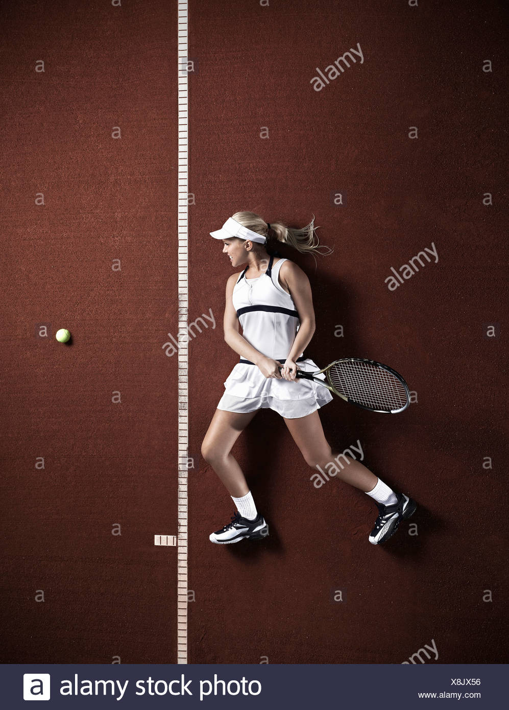 Tennis player laying on court - Stock Image