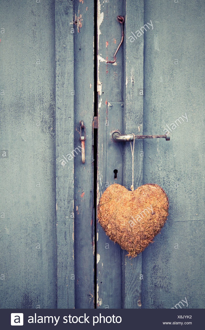 Close-up of door with a heart - Stock Image