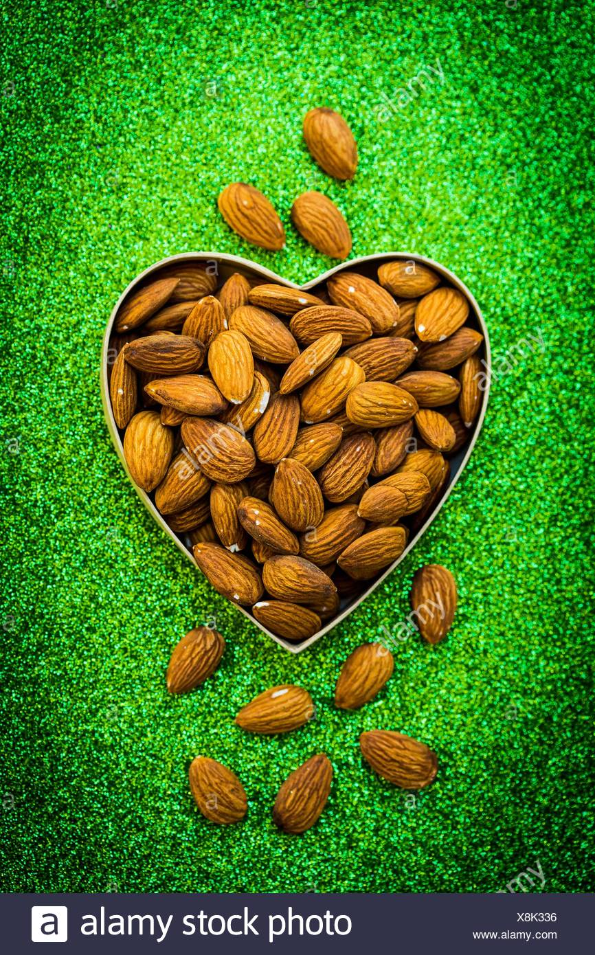 Almonds in heart shape. - Stock Image
