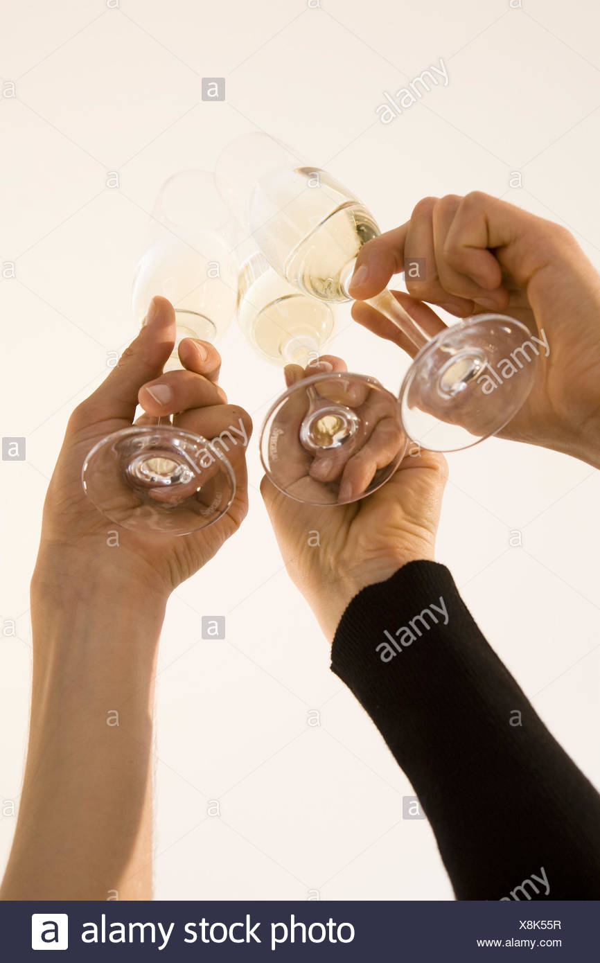 Hands, champagne glasses, detail, clink glasses - Stock Image